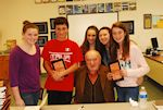 Fred with students after he signed their books