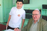 Holocaust survivor Fred Spiegel and a student from Dennis Township Elementary School