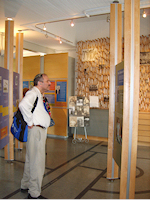 Evan Fishman, chair of the trip to the South Jersey Agricultural Colonies during the 29th International Conference on Jewish Genealogy examines the exhibits in The Sam Azeez Museum of Woodbine Heritage during the groups visit