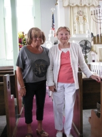 Gloria Weitzenhof, widow of holocaust survivor Arnold Weitzenhof and holocaust  survivor Hannah Erlich visiting the sanctuary of the Sam Azeez Museum/Woodbine Brotherhood Synagogue.