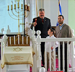 Lighting of the final Chanukah candle by Woodbine Mayor Bill Pikolycky, Rabbi Avrom Rapoport and Yoni Biering from the Hebrew Academy