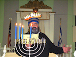 Rabbi Yisroer Rapoport of Vineland Lights the 3rd Chanukah Candle at the Museum